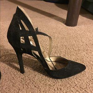 Black suede pointed/closed toe heel.